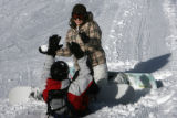 MJM824   Taking a break from snowboarding, Merissa Berdeauz (cq), 18, of Greeley, top, attempts to...