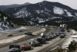 MJM107 Drivers resort to making u-turns in the medium Friday as I-70 traffic begins to back up a...