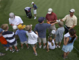 (Castle Rock, Colo., August 3, 2004) From left-Bob Burns, Steve Pate and Jeff Brehaut sign...