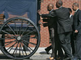 Funeral Director Ronald L. Jones (CQ) , left, and his staff close the door to a horse drawn...