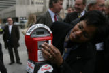 DLM1754  Dr. Jandel Allen-Davis plugs change into a new Donation Meter, which is part of a new...