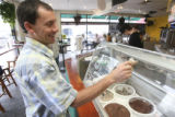 Tim Gargiulo, (cq), CEO and Founder, wipes a spot from the ice cream case. The former professional...