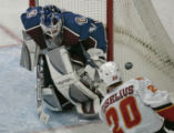 Colorado Avalanche goaltender Peter Budaj, left, makes good on one of his 33 saves against a shot...