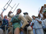 "Chris Foud (cq), of Ark., dances on the float ""Grannies Gone Wild"" during the Mardi Gras..."