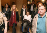 Molly Bloom (cq) leaves Denver County Court in her wheelchair Tuesday morning February 20,2007...