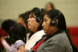 Rosa Lopez, cq, listens to a press conference being translated in to spanish, Tuesday Feb. 20,...