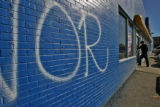 Gang graffiti stands out on this bright blue NAPA store Wednesday afternoon February 21, 2007, 600...