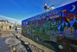 Gang graffiti stands out on this Westwood Community Mural, painted on a wall at the Car Wash...