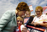 (Denver, Colo., August 18, 2004) First Lady Laura Bush hugs Mackenzie Hammers, 8, as she leaves...