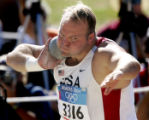 OLYMPIA, GREECE, AUGUST 18, 2004) United States' shot put thrower, Adam Nelson, makes his second...