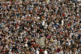 (OLYMPIA, GREECE, AUGUST 18, 2004) Fans sit along the grass banks of the Ancient Stadium in...