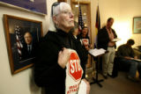 Jane Bostwick, cq, of Boulder stands along a wall at Sen. Ken Salazar's Denver office Thursday...