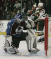 JOE590 Colorado Avalanche goalie Peter Budaj (31) looks down at the puck as Minnesota WildAdam...