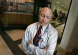 Agent Don James stands in the lobby of the Aurora Police Dept. Aurora, Colo. Tuesday, March 6,...