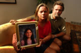 (DENVER, CO. - AUGUST 18, 2004)  Valerie Meyer, and husband Dennis Meyer hold a photo of their...