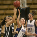 Harrison's Raquel Penninton, left, and Broomfield's Ashley Snow, middle, fight after a rebound as...