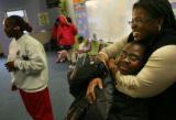 MJM912  Lark Purdue, 12, is hugged by Open Door Youth Gang Alternative Program organizer, Terri...