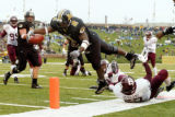15 November, 2003 -- Missouri running back Damien Nash (2) breaks free from a tackle by Texas...