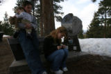 (DLM5224) -  Stephanie Schadegg looks at one of the momentos left at the gravesite of Stephanie...