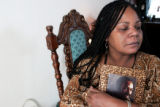 Luanna Sims (cq , holds a photo of her  deceased husband  Ruben Sims, at her Aurora home Sunday...