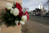 Flowers memorialize the spot near Williams and Bruce Randolph  streets near where Gilbert Garcia,...