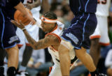 The Denver Nuggets' Allen Iverson (#3) dives for a loose ball against the Utah Jazz during the...