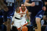The Denver Nuggets' Allen Iverson (#3) looks to push the ball up court against the Utah Jazz...