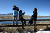 Nataline Awingers, 9, Sienna Rahe, 9, and Kelsey Quick, 9, enjoy looking and taking photos of the...