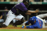 (DENVER, Co., SHOT 8/4/2004) Colorado Rockies' catcher Charles Johnson (left) tags the Chicago...
