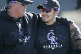 Colorado Rockies head coach Clint Hurdle, left, has a heart to heart with pitcher Rodrigo Lopez...