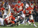 John Sleezer/The Kansas City Star 11/23/2006  (SPORTS) The Kansas City defense led by defensive...