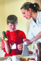 [JOE127]  Drew Pasma, (cq) 11, of Niwot, Colo., left, reacts to grating an onion while preparing...