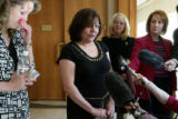 Gail Livesay , cq, (center) speaks to the press after the press outside a Jefferson County...