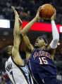TNMW107 - New York Nets' Vince Carter, right, drives around Memphis Grizzlies' Tarence Kinsey in...