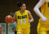 Regis University's Denise Lopez (#43), and her twin sister Diana, are the top two scorers for the...