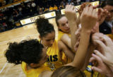 Regis University's Denise (#43, left center) and Diana Lopez (#31, far left), twin sisters from...