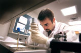 (DENVER, Colo., May 13, 2004)  Quality Systems Specialist Eric Kotaska of Parker adds reagents to...