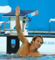 (ATHENS, GREECE-AUGUST 19, 2004)  United States' Aaron Peirsol waves to the crowd after winning...