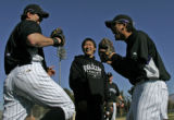 Colorado Rockies team leader Todd Helton, #17, left, and Kazuo Matsui, #7, right, horse around...