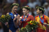 (Athens, Greece  on Wednesday, Aug. 19, 2004) -  American gymnast Carly Patterson, center, looks...