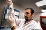 (DENVER, Colo., May 13, 2004)  Quality Systems Specialist Eric Kotaska of Parker draws reagent out...