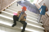 Representative Bernie Buescher, (cq), (D)-Grand Junction, sits with his props on the steps inside...