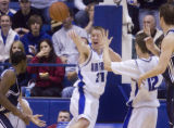Airforce Academy's Jacob Burtschi (21 white) saves the ball from going out of bounds in the first...