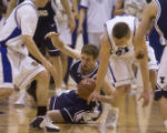 Brigham Young's Jimmy Balderson, falls to the floor being defended by Airforce Academy's Tim...
