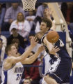 Airforce Academy's Jacob Burtschi, left, knocks the ball loose from Brigham Young's Trent...