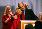 Republican candidate for Governor Bob Beauprez (right) hugs his wife Claudia at the podium as he...