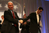Republican candidate for Governor Bob Beauprez, cq,  (left) tugs his campaign manager John...