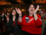 (Denver, Colo., November 7, 2006) Joan Morgan, right, celebrates the news that Angie Paccione is...