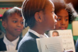 Watch-Care Academy students Alyssa Jordan, cq, 7, Destiny Nave, cq, 8, and Joaquin Smith, cq, 8,...