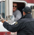 Mesa County Deputy Chadd Searcy contacts an unidentified truck driver at a Garfield County...